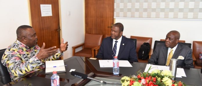 Mr Asamoah-Boateng (left) interacting with Dr Haldane Davies (middle) and Mr Austin Gamey