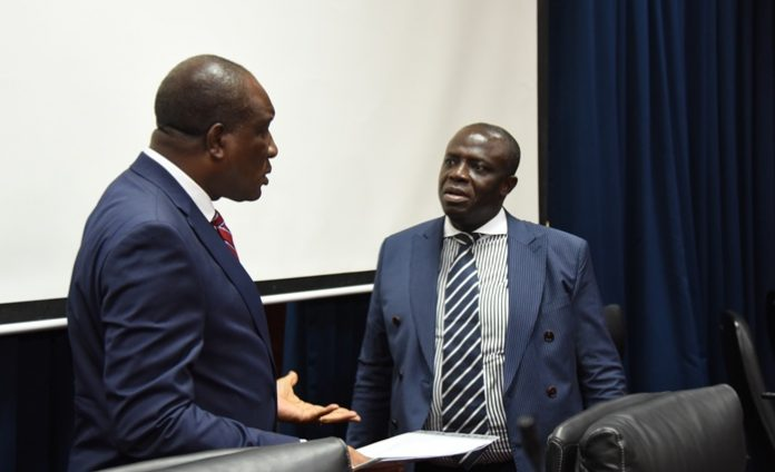 Justice Nene Amegatcher (left) and Sir Justice Dennis Adjei interacting at the colloquium