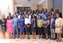 The facilitators and participants in a group picture after first session