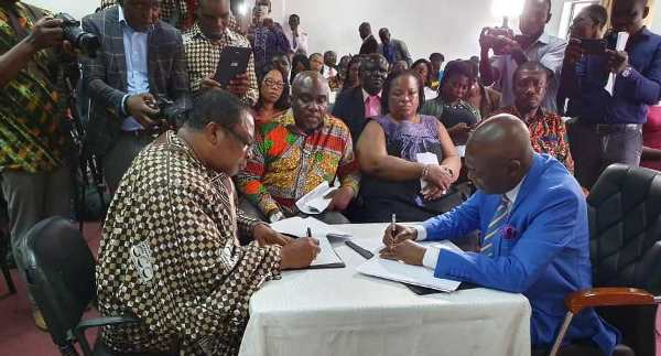 Nana Dr Appiagyei Dankawoso (left) and Mr Austin Gamey signing the MoU