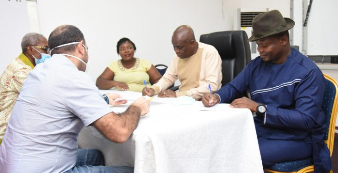 Mr Edem Agbegbor (right), Mr Austin Gamey (second right) and Ziad Ofali (left) and Sika Addo (third right) signing the CA