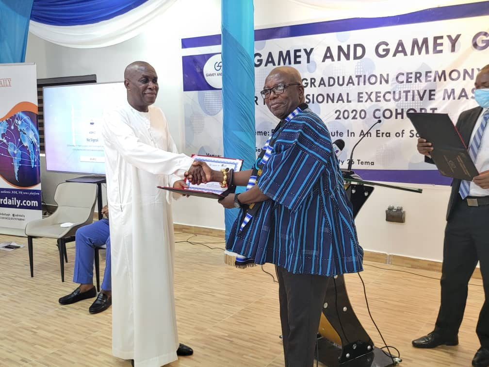 Mr Gamey (left) presenting a certificate to Nana Poma Kwaaduah XVIII, a traditional leader