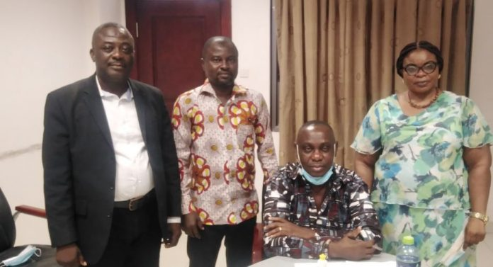Mr Turkson (seated) and Togbe Amedzake (left) with Edmund Mingle after one of the mediation sessions at the High Court.